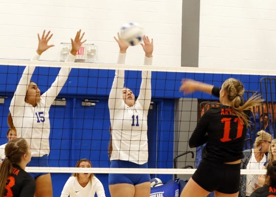 "Carlsbad's Serena Rodriguez and Jaelee Borque go to block Kaylee Wagner's spike attempt during Tuesday's match at ""The Cave"" in Carlsbad. Artesia won in straight sets."
