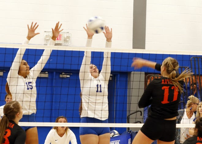 """Carlsbad's Serena Rodriguez and Jaelee Borque go to block Kaylee Wagner's spike attempt during Tuesday's match at """"The Cave"""" in Carlsbad. Artesia won in straight sets."""