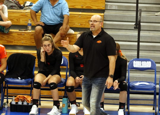 Artesia volleyball coach Alan Williams yells out instructions during a point against Carlsbad on Aug. 27, 2019. Artesia finished the regular season 18-4 and has the No. 3 seed in the 2019 4A NM state playoffs.