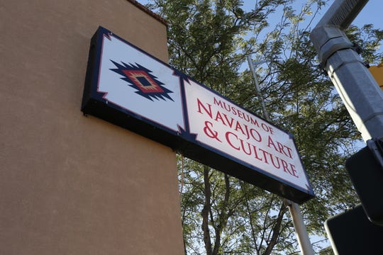 A new lighted sign hangs above the Museum of Navajo Art and Culture in downtown Farmington.