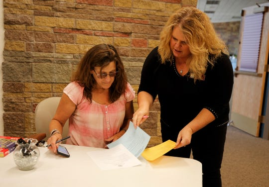 County Clerk Tanya Shelby helps DeAnne McKee file paperwork to run for election, Tuesday, Aug. 27, 2019. She is seeking reelection to the San Juan Soil and Water Conservation District board of supervisors.