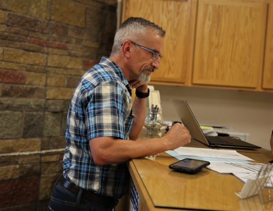 Roger Collins files candidacy paperwork, Tuesday, Aug. 27, 2019, for the Aztec school board.