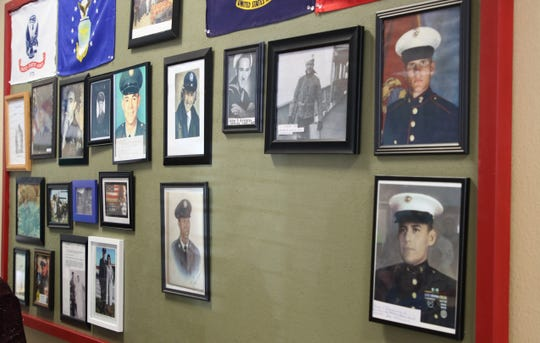 A wall featuring portraits of military veterans with close ties to the Bonnie Dallas Senior Center is unveiled at the facility during an open house on Aug. 28.