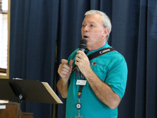 Jack Lowery, the adult programs manager at the Bonnie Dallas Senior Center in Farmington, makes a series of announcements during an open house at the facility on Aug. 28.