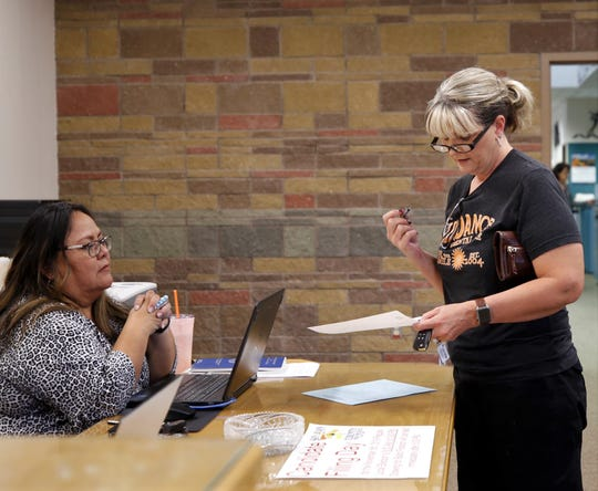 Tamie Hemmingson files paperwork for Aztec School Board, Tuesday, Aug. 27, 2019, at San Juan County Clerk's Office in Aztec.
