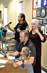 """Chris Chavez, top, Sallyanne Bachman and Sheldon Pickering perform """"Amazing Grace"""" during an open house at the Bonnie Dallas Senior Center on Aug. 28."""