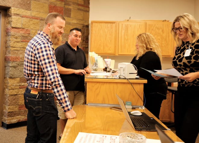 Joel Gunn and Dale Maes file paperwork to run for Bloomfield school board, Tuesday, Aug. 27, 2019, at San Juan County Clerk's Office in Aztec.
