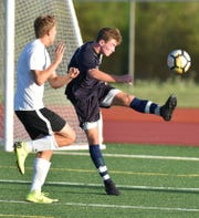 South Lyon soccer player Matthew Moore boots the ball out of his goalie's area during the Lions' Aug. 27 game against Milford.