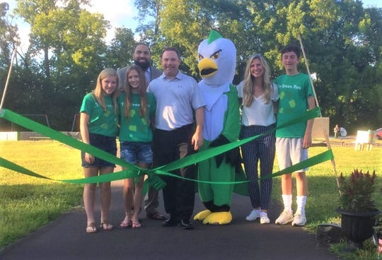 Bird students and staff joined efforts to make the path on the school grounds possible.