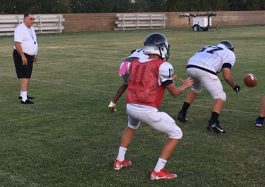 New head coach David DeWoody runs practice for the Desert Chapel Eagles as they prepare to open the season Thursday night.