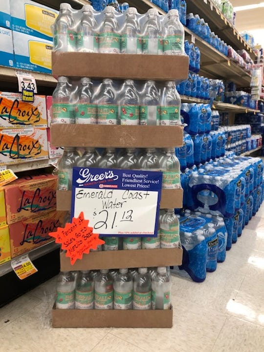 Cases of Emerald Coast Ultra Pure Water are pictured on the shelves at Greer's CashSaver grocery store in Pensacola.