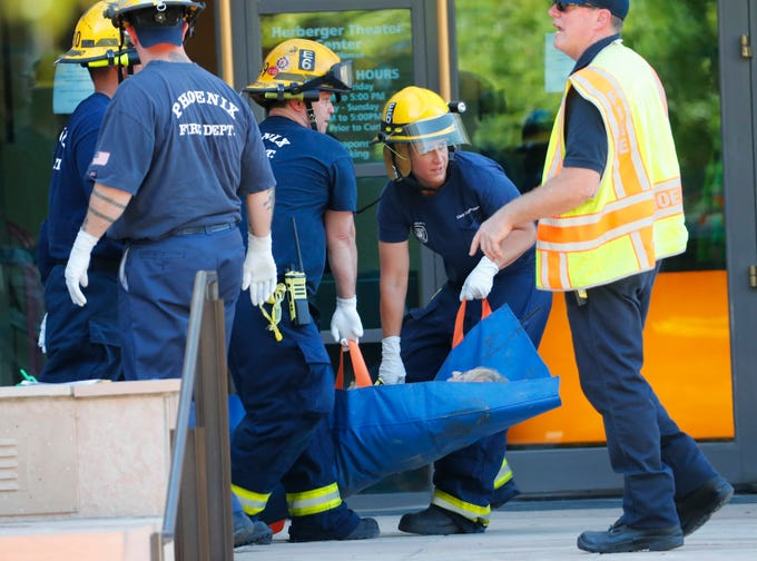 """""""Injured"""" people are taken out of the Herberger Theater during an active shooter drill in Phoenix on Aug. 28, 2019."""