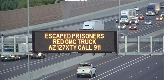 A digital sign over Interstate 10 in Phoenix seeks the public's help in locating escaped murder suspects on Wednesday, Aug. 28, 2019.