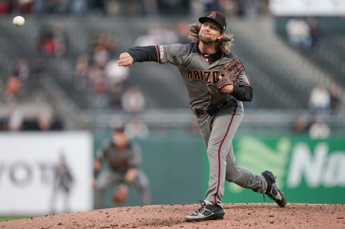 Aug 27, 2019; San Francisco, CA, USA; Arizona Diamondbacks starting pitcher Mike Leake (8) pitches against the San Francisco Giants during the first inning at Oracle Park.