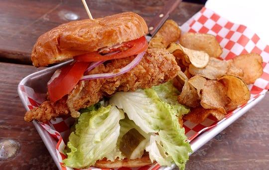Crispy Clucker with crispy fried chicken breast, coleslaw, pickles, honey and Dijon at Handlebar Diner in Mesa.