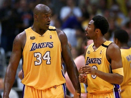 Los Angeles Lakers' Shaquille O'Neal, left, and Kobe Bryant talk it up during a break of Game 6 of the NBA Finals against the Indiana Pacers at the Staples Center on Friday, June 16, 2000. (AP Photo/Kevork Djansezian, File)
