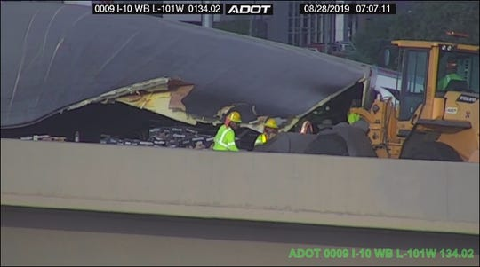 A semi truck rolled over and blocked the ramp from the east I-10 to north Loop 101 on Wednesday, Aug. 28, 2019.
