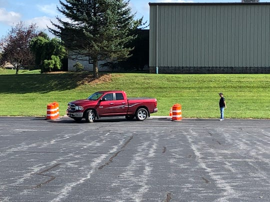 A young driver practices parallel parking at a station at Wolf Driver's Training School, which can now issue a valid Pennsylvania driver's license upon completion of a test.