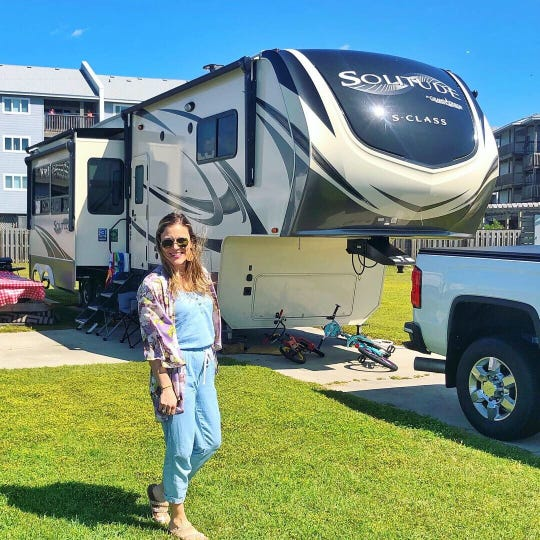 Heather Nikola stands next to her family's 2019 Grand Designs Solitude Fifth Wheel at the Camp Hatteras RV Resort and Campground in the Outer Banks, North Carolina.