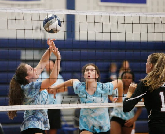 Millbrook's Cecilia Dignan sets the ball for Natalie Fox during a scrimmage at Millbrook High School on August 28, 2019.