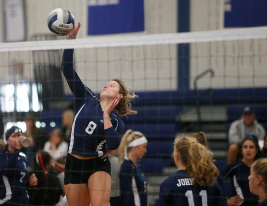 John Jay's Torrie Urbanowicz goes up to spike the ball during a scrimmage at Millbrook High School on August 28, 2019.