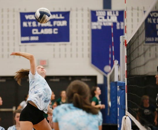 Millbrook's Gabby Radovic goes up to spike the ball during a scrimmage at Millbrook High School on August 28, 2019.