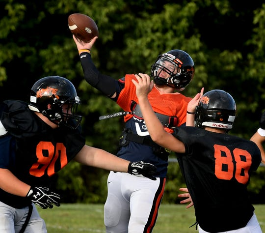 Northeastern quarterback Zech Sanderson launches a pass during practice at the school Tuesday, Aug. 27. Bill Kalina photo