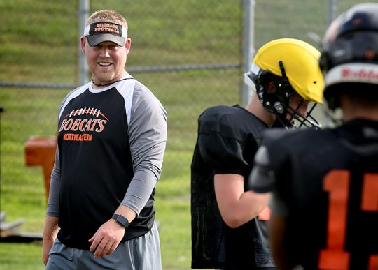 Northeastern head coach Jon Scepanski talks with players during practice at the school Tuesday, Aug. 27, 2019. Bill Kalina photo
