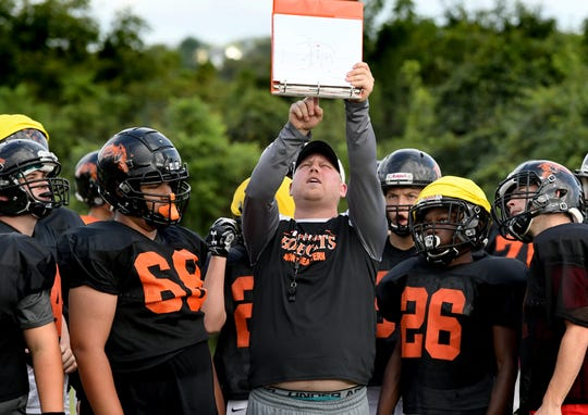 Northeastern head coach Jon Scepanski calls an offensive play during practice at the school Tuesday, Aug. 27, 2019. Bill Kalina photo