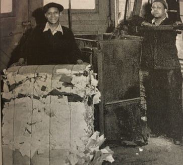 George Redman, left, and Jim Redman bale waste paper collected daily at York Corporation, a leading York Plan company. The paper would eventually become shell containers.