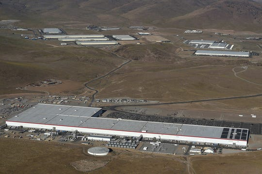 Tesla's Gigafactory (foreground) is seen from the air on Aug. 24, 2019.