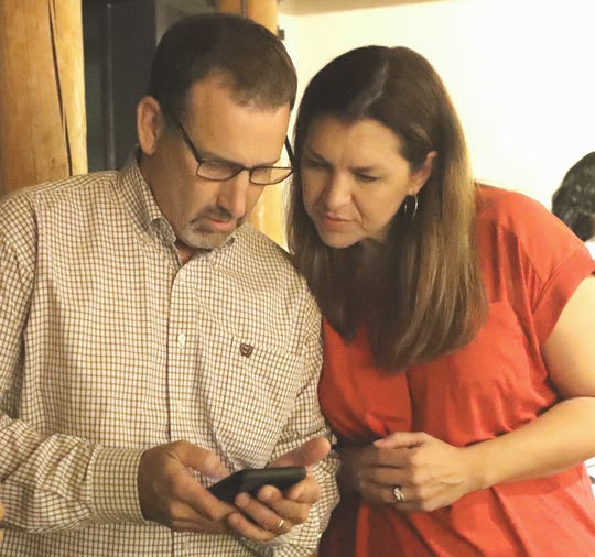 Republican Megan Dahle, right, checks early election results with husband, state Sen. Brian Dahle, on Tuesday night, Aug. 27, 2019, at her election watch party in Redding. Megan Dahle, of Bieber, is seeking to win the Assembly District 1 seat that was vacated when her husband was elected to the California Senate.