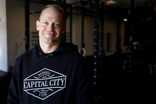 Justin Devereux, a Salem-Keizer middle school teacher, broke an American record to win gold in the World Masters Weightlifting Championship. Photographed at Capital City Barbell in Salem on Aug. 28, 2019.