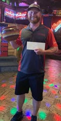 Nick Rowton poses with his trophy and prize money from the 2019 New Mexico State Disc Golf Championships on Sunday, Aug. 25, in Ruidoso.