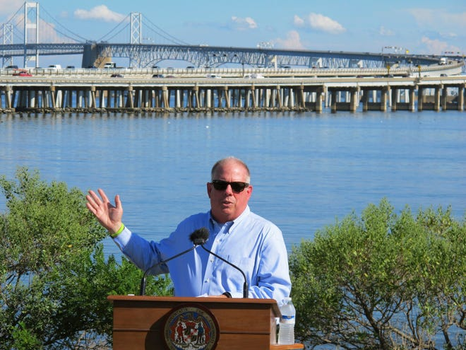 In this Tuesday, Aug. 30, 2016, file photo, Gov. Larry Hogan speaks at a news conference near Annapolis, Md., with the Chesapeake Bay Bridge in the backdrop. In an announcement Tuesday, Aug. 27, 2019, Maryland transportation officials said they have narrowed the possibilities for a new crossing over the Chesapeake Bay to three areas near the current Bay Bridge.