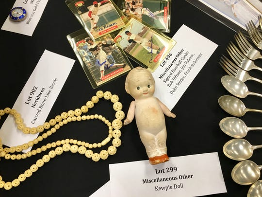 Baseball cards, beads and a Kewpie doll set to be on offer at the State Treasurer's annual unclaimed property auction in Springfield Sept. 10-11.