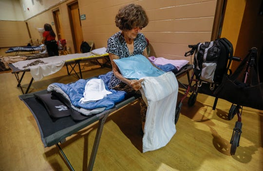 Jenetta Stevens puts her bed together at Safe to Sleep on Friday, July 19, 2019, in Springfield, Mo. Stevens is one of the members of the aging homeless population.