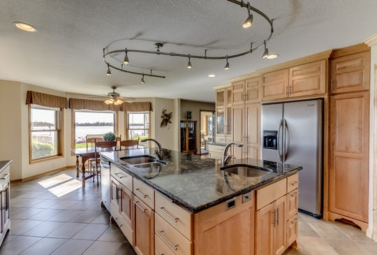 The gourmet kitchen is fully updated and includes not only a double oven but a cooktop with a pot filler and range hood.