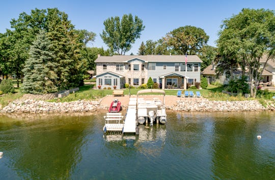 This fully remodeled six-bedroom home sits just off 100 feet of Big Lake shoreline.