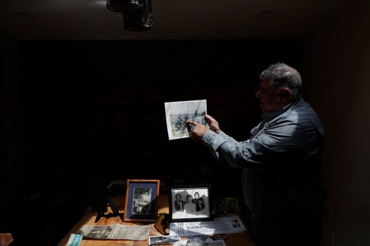 Mark Friedemann points to his father in one of hundreds of photos he found in boxes that his father, Richard Friedemann, kept throughout his 92 years of life.