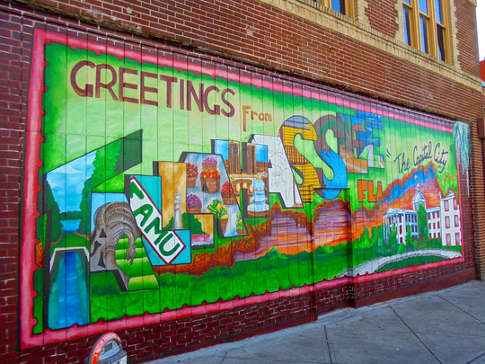 The  Tallahassee Postcard Mural has been removed and will be donated to the Downtown Improvement Authority and will be placed elsewhere in a TBD downtown location