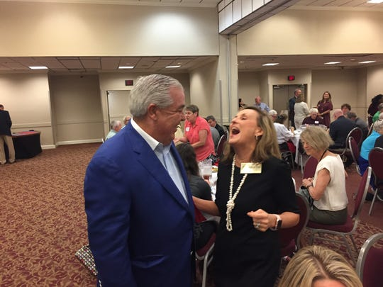 John Morgan laughs with Allison Tant, a candidate for Florida House District 9, at Tiger Bay on Aug. 28.