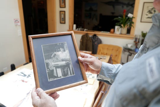 Mark Friedemann holds a photo of the mother of his father, Richard Friedemann, who died during the Holocaust.