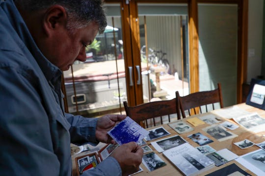 Mark Friedemann looks through one of hundreds of photos, documents and other items his father, Richard Friedemann, collected over his 92-year-long life.