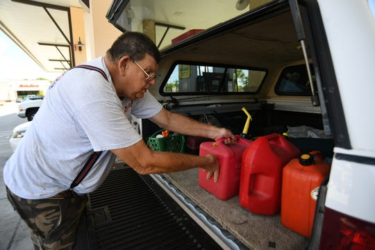 "Al Smith, of Tropical Farms, picks up extra gasoline for his backup power generator at the Race Track gas station along Kanner Highway near Interstate 95 in Martin County, on Wednesday, Aug. 28, 2019, in preparation for Hurricane Dorian. ""I'm just getting prepared for the hurricane,"" Smith said. ""I can't take any chances. I hope it misses us, but you can't take any chances, it's too big."""