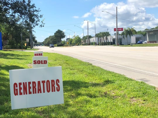 "Signs reading ""Generators sold here"" were placed in front of the Vatland Honda Dealership in Vero Beach Monday by parts manager Mark Nenadic. Generator sales always spike in the midst of an incoming storm, Nenadic said."