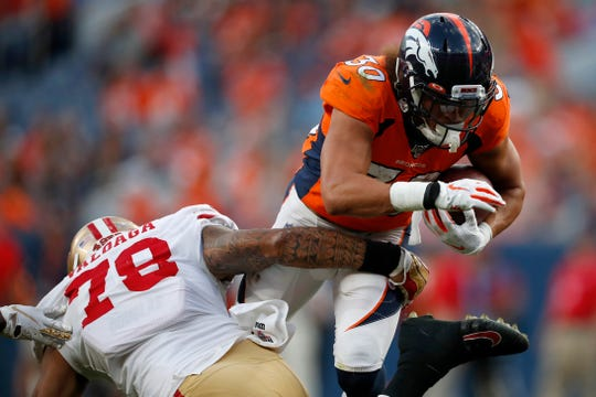San Francisco 49ers defensive end Jeremiah Valoaga, a Channel Islands High graduate, stops Broncos running back Phillip Lindsay during a preseason game on Aug. 19.