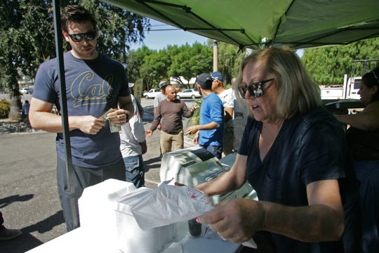 Elks Lodge member Christine Harrison fills an order for Thousand Oaks resident Nate Bennett during the weekly Saturday barbecue at Thousand Oaks Elks Lodge No. 2477. The event is a fundraiser for local charitable programs.