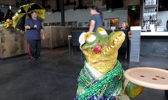 A crocodile sits at the entrance of Louisiana Seafood House by EMC at The Collection in Oxnard.