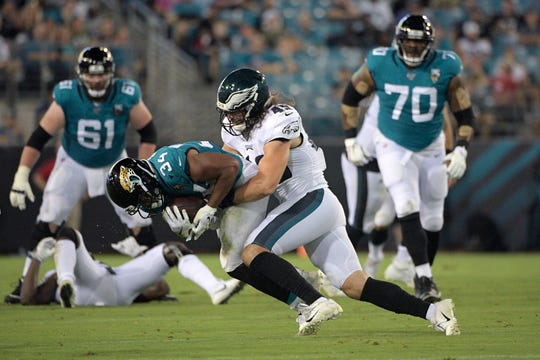 Eagles linebacker Alex Singleton tackles Jaguars running back Thomas Rawls  during a preseason game on Aug. 15. Singleton, a Thousand Oaks High graduate, is hoping to make the Eagles' final roster.
